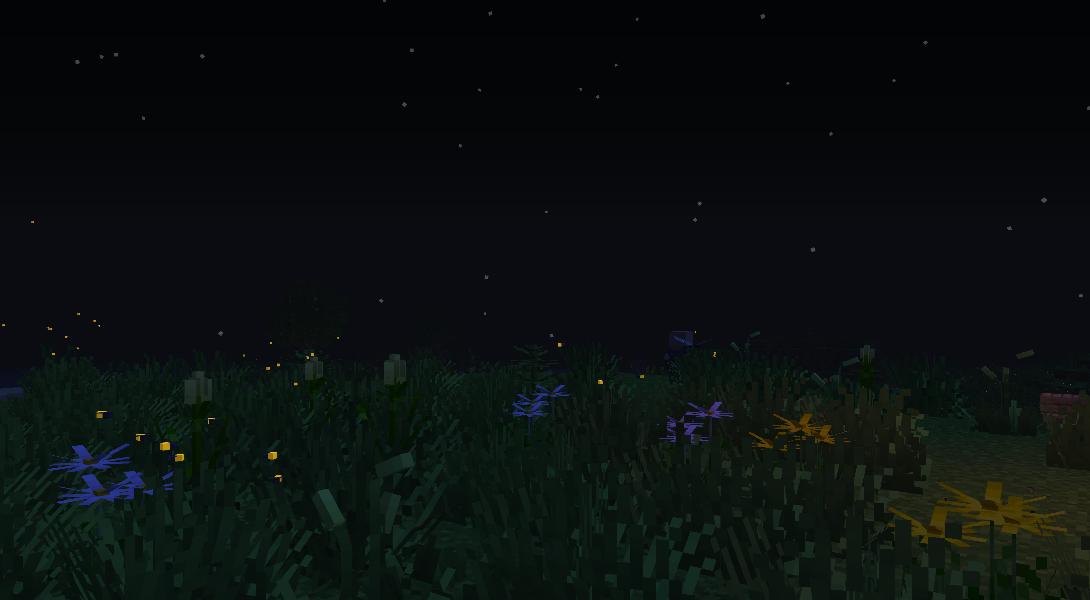 Des lucioles apparaissent la nuit dans la nature
