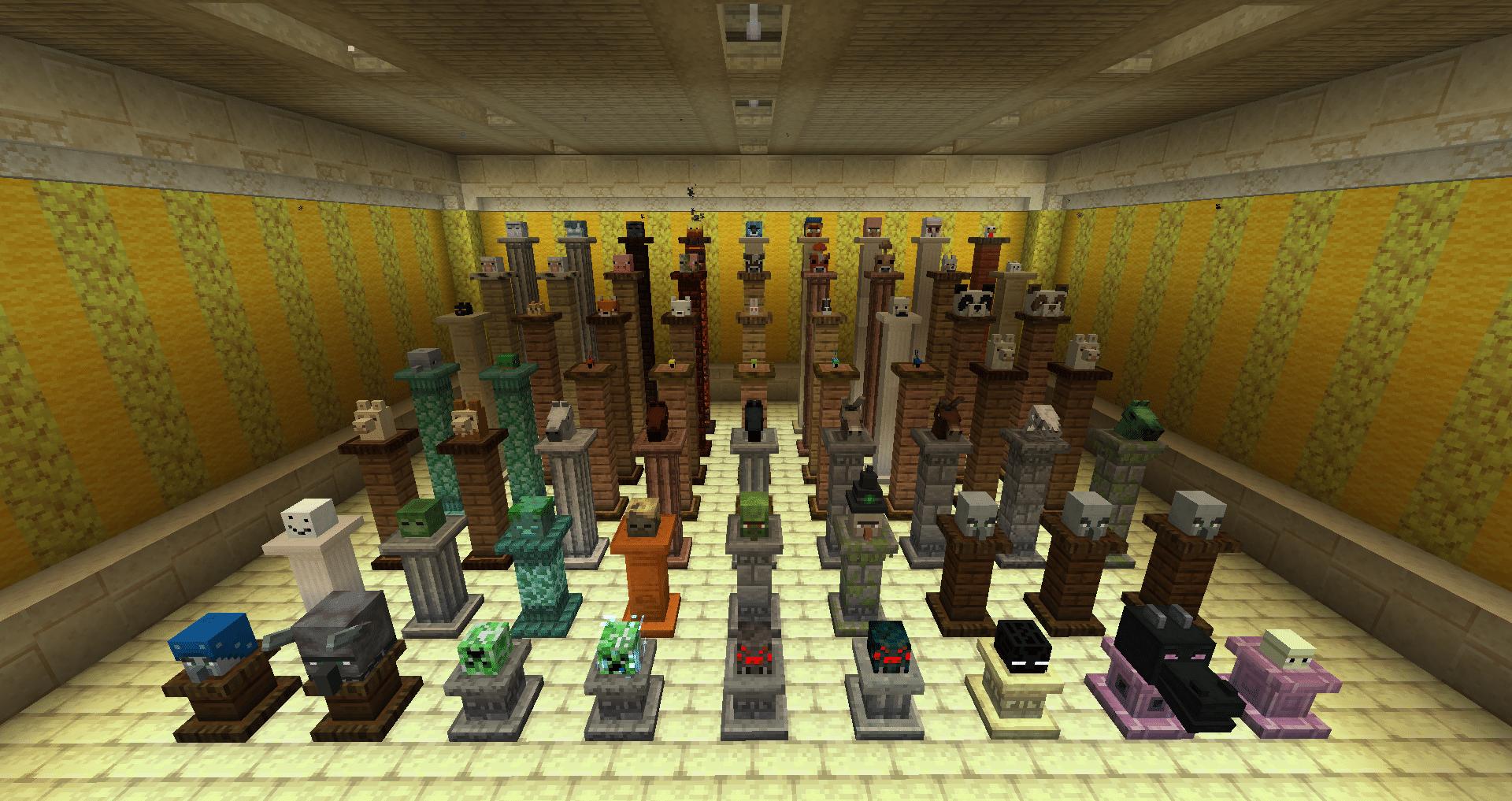Quelques têtes de créatures dans Minecraft avec les pilliers.